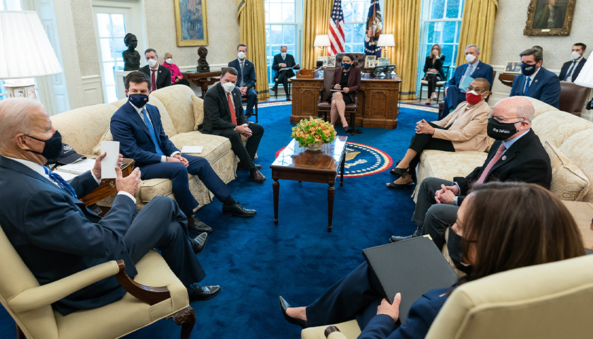 Joe Biden talking to staff members