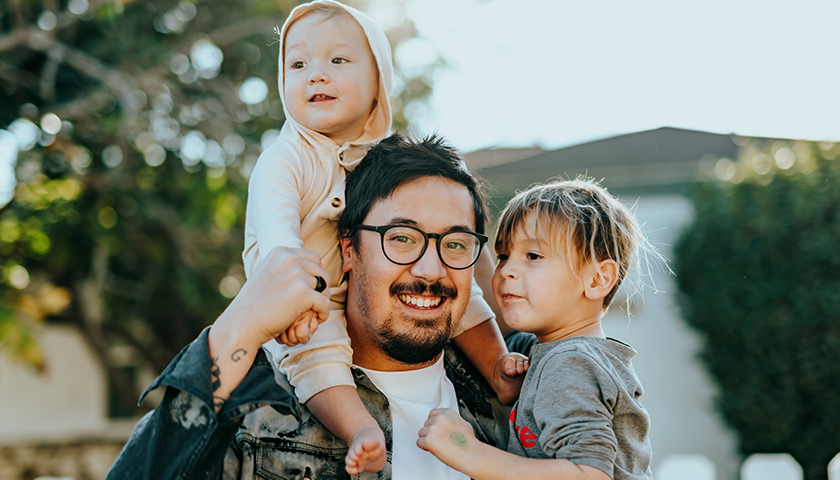 Man with two children