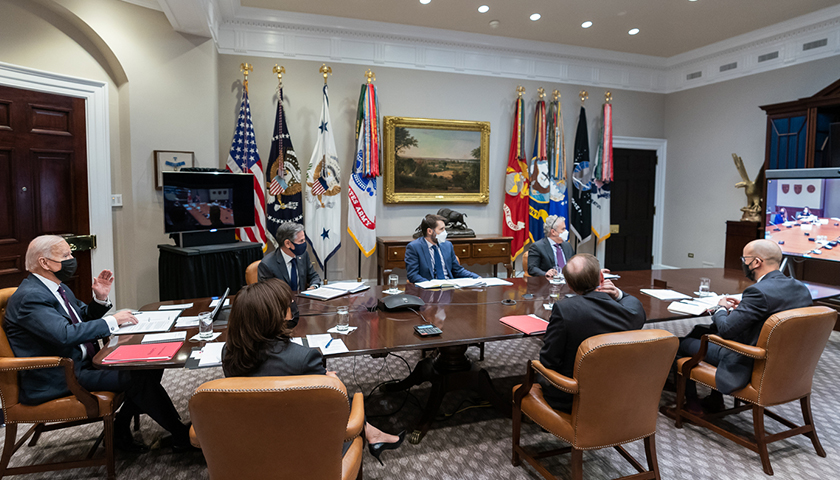 President Joe Biden and Vice President Kamala Harris, joined by White House staff, participate in a virtual bilateral meeting with Canadian Prime Minister Justin Trudeau on Tuesday, Feb. 23, 2021, in the Roosevelt Room of the White House. (Official White House Photo by Adam Schultz)