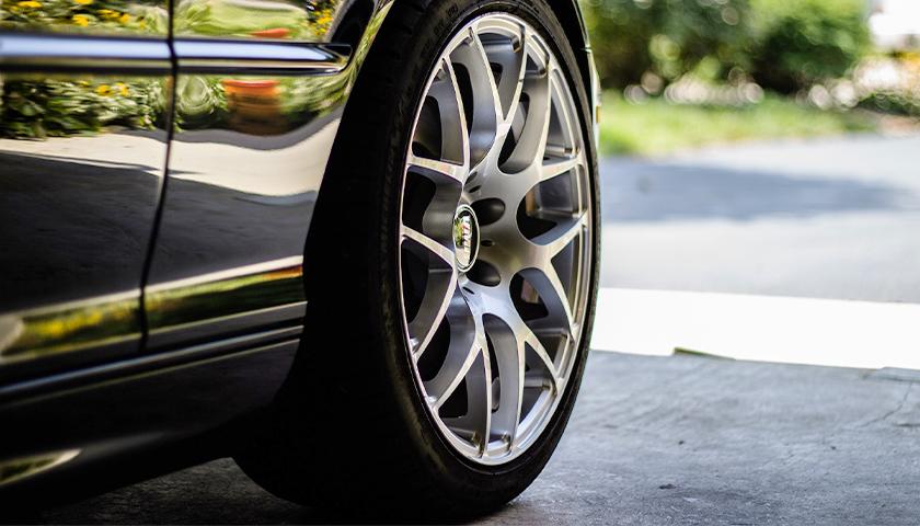 Car Tire In Driveway