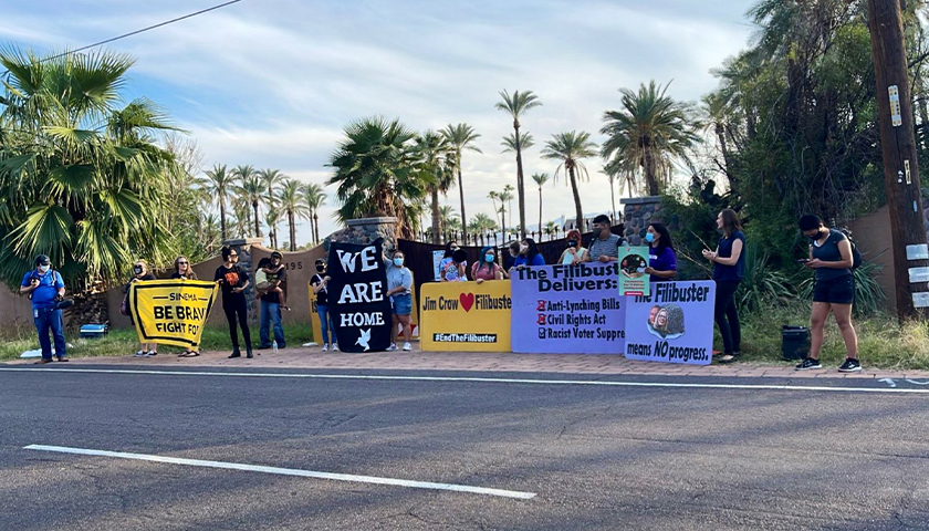 LUCHA Arizona protesting outside during the day about the filibuster